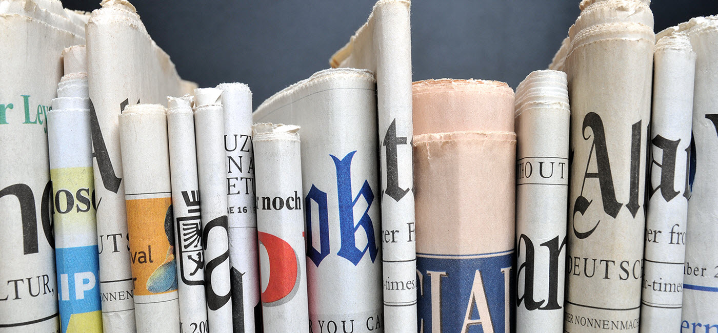 Spine view of newspapers.