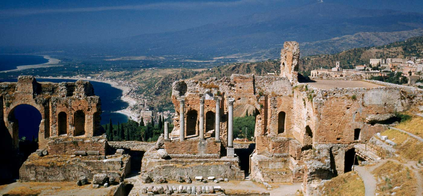 Ruins of a building on a hillside in Taormina, Sicily, Italy.